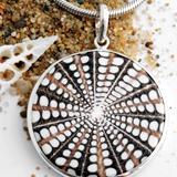 Spider-Shell Pendants