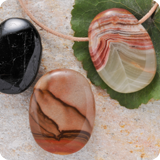 Gemstone pendants in oval shape.