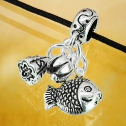 Silver charm with fish pendant, money bag and flower