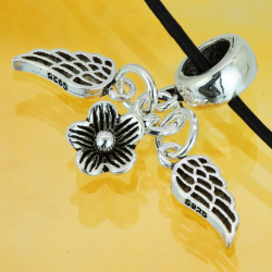 Silver pendant with angel wings and flower