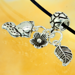 Silver pearl with hanging fox, leaf and flower