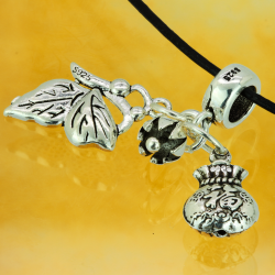 Silver tube with pendant purse, seated butterfly and flower