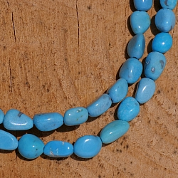 Turquoise beads A + natural shape 7x5mm 40cm