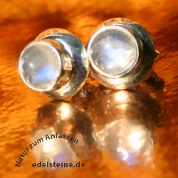 Moonstone stud earrings round silver edge
